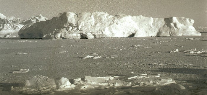 An ice berg in sea-ice off Rothera Point in Winter.