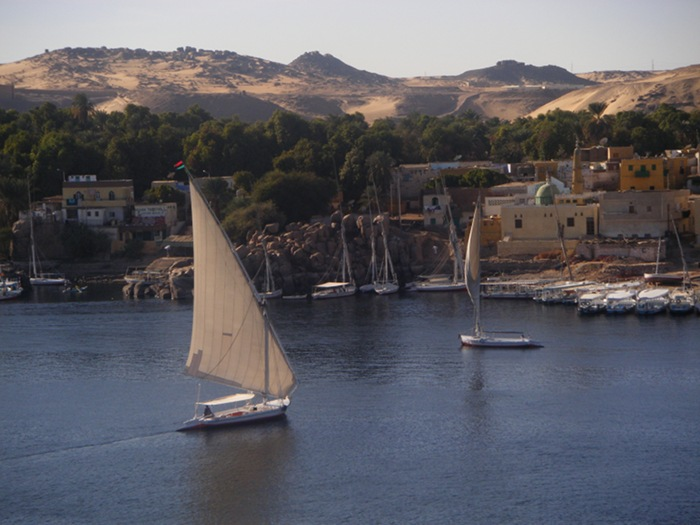 Feluccas sailing on the Nile seen from our hotel room window in Aswan.