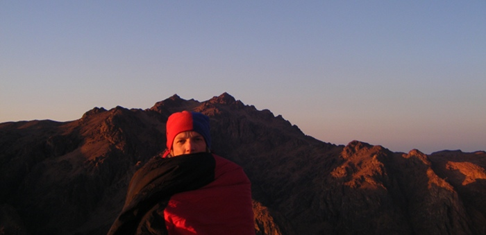 Me, cold and tired, on the summit of Mount Sinai watching the sun rise.