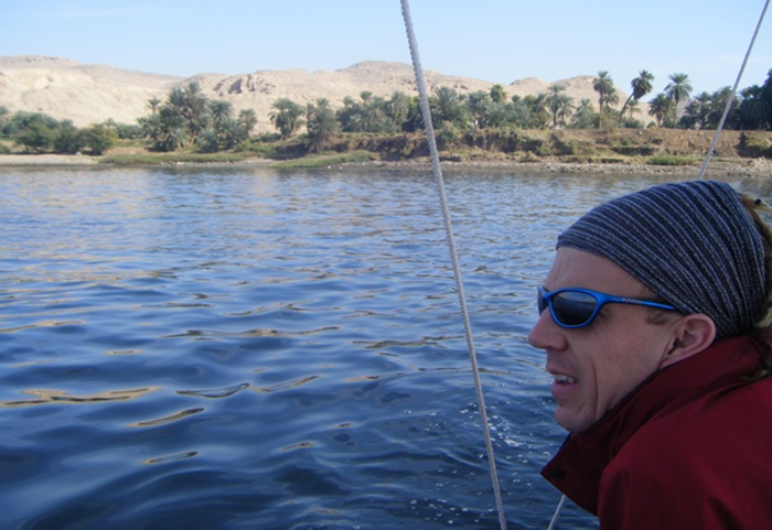 Me looking out from the felucca as we gently sailed down the Nile. There was a small amount of green life on either bank but then the desert resumed. It was pretty chilly until after midday!