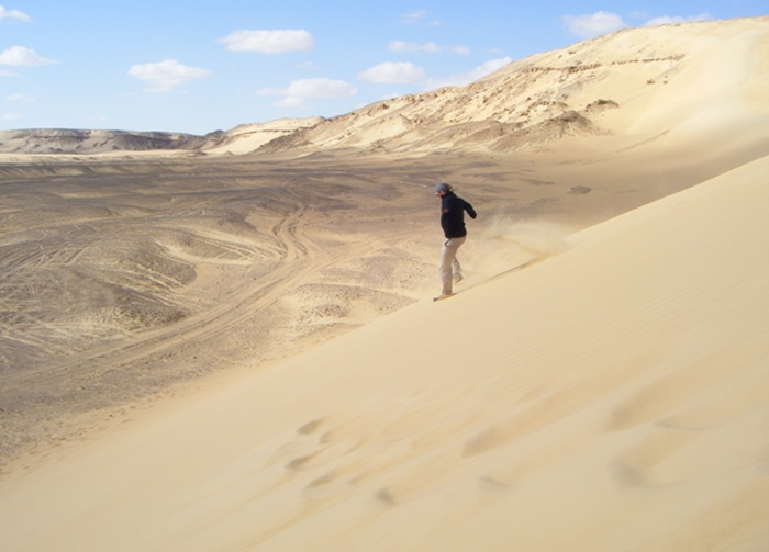 Running down a dune in the western dessert.