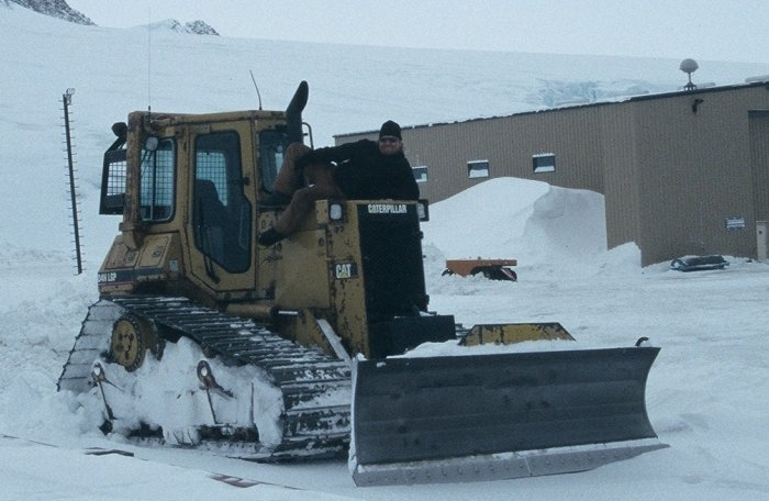 Chrissy J with his favourite bull-dozer after clearing snow for the South Pole evacuation flight.