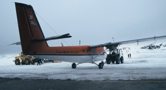 The Canadian Twin Otter being backed into the hangar after landing for the South Pole flight.