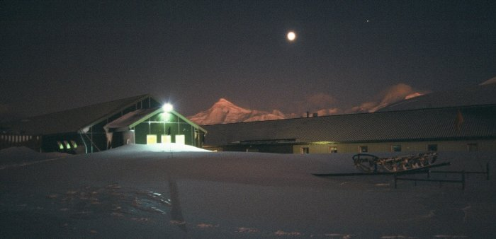 Fuchs House (the field store) and Admirals House (the main accomodation building) during the permanent darkness of winter.