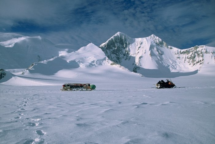 My skidoo and sledge in front of mountains on Adelaide Island during a winter trip.