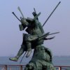 A statue in Shimonseki commemorating a famous local legend of two warriors fighting in the Kanmon Straits.
