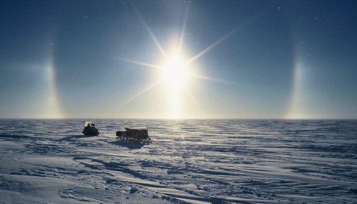 A halo around the sun. My skidoo and sledge are being used during a training session before my first winter trip.